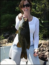 woman with smallmouth bass